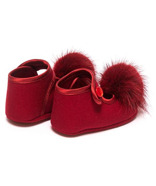Newborn shoes with pom poms